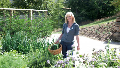 Annabel Langbein collecting vegetables.