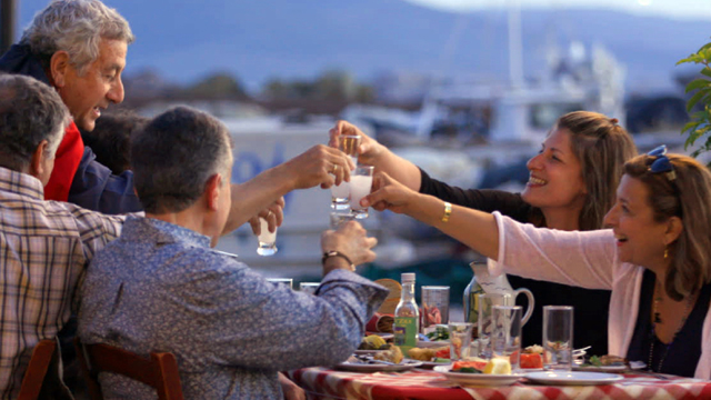 Diane gets an insider's taste of ouzo with a good friend and local son on the islnad of Lesvos.