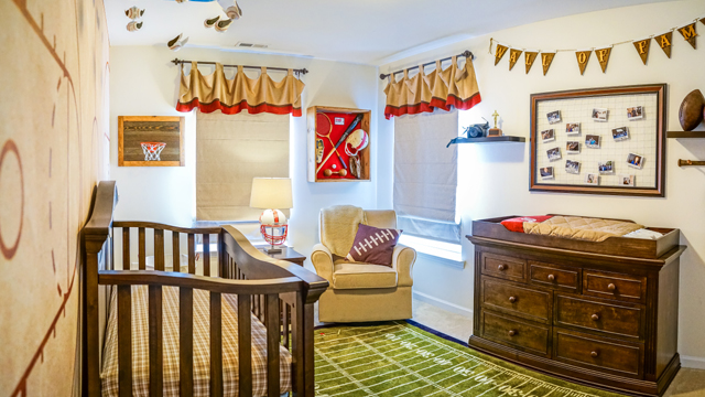 Schrita and Shante welcome a baby of their own with a vintage sports themed nursery