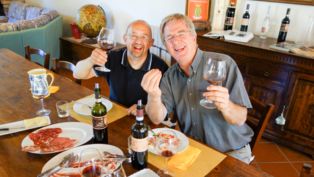 Rick enjoys a meal with guide Roberto Bechi.