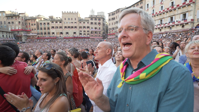 Rick cheers with the crowd at the Palio in Siena, Italy.