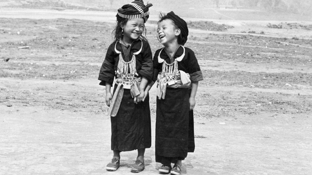 Two girls in traditional Hmong clothes