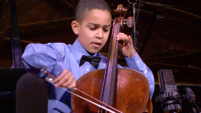 Musical prodigy and cellist Lev Mamuya performs at a recital.