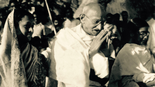 "Gandhi greets villagers on his grass-roots peace pilgrimage called ""The Miracle of Noakhali"" IN East Bengal (1946-47)."