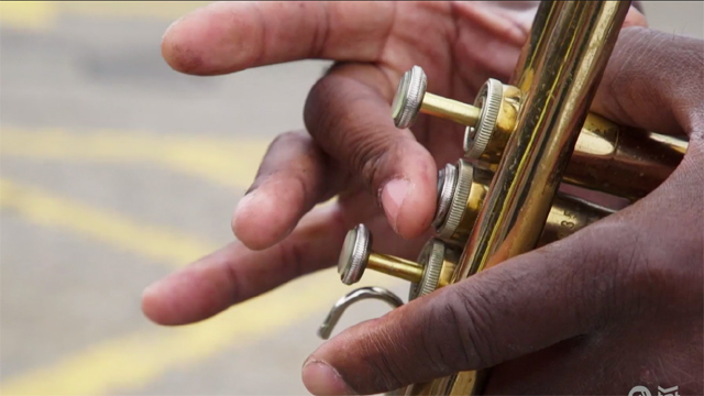 Jocephus Lomax, also known as Music Man Joe, busks on the streets of Minneapolis.