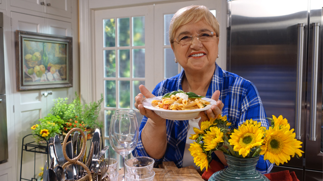 "Lidia beckons ""Tutti in cucina a cucinare!"" or ""Everyone to the kitchen to cook!"""