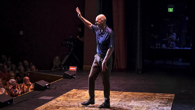 Rowdy Gaines, Olympic swimmer, tells an embarrassing story on stage
