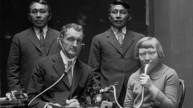 J. P. Harrington posing with three Cuna (Tule) people while making Dictaphone recordings of Cuna language and songs, 1924. [BAE GN 4305 A, National Anthropological Archives, Smithsonian Institution. Photo Credit: National Anthropological Archives, Smithsonian Institution